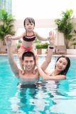 Happy family in swimming pool. Summer holidays and vacation conc. Ept Stock Images