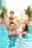 Happy family in swimming pool. Summer holidays and vacation conc. Ept Royalty Free Stock Photography