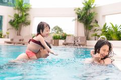 Happy family in swimming pool. Summer holidays and vacation concept royalty free stock image