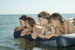 Happy family swimming Royalty Free Stock Images