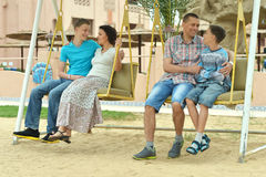 Happy family on a swing Stock Photography