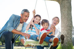 Happy family swing Royalty Free Stock Photography