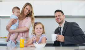 Happy family at table in house Stock Images