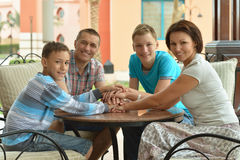Happy family on the table Stock Photography