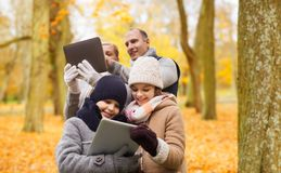 Happy family with tablet pc in autumn park royalty free stock photos