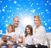 Happy family with tablet pc computers Royalty Free Stock Images