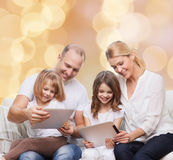 Happy family with tablet pc computers Royalty Free Stock Photos