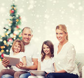 Happy family with tablet pc computers at home Royalty Free Stock Photos