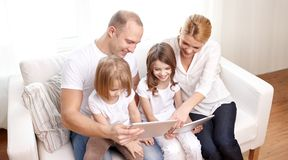 Happy family with tablet pc computers at home Royalty Free Stock Image