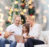 Happy family with tablet pc and credit card Stock Photos