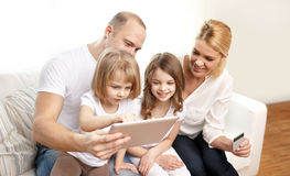 Happy family with tablet pc and credit card Stock Photography