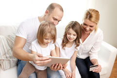 Happy family with tablet pc and credit card Stock Photo