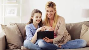 Happy family with tablet pc at home stock video