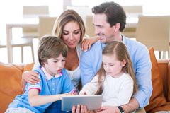Happy family with tablet pc stock photography
