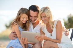 Happy family with tablet pc taking picture Stock Photo