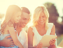 Happy family with tablet pc taking picture Stock Photos