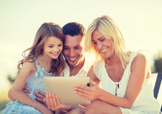 Happy family with tablet pc taking picture Royalty Free Stock Images