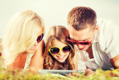 Happy family with tablet pc taking picture Royalty Free Stock Photos