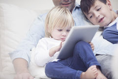 Happy family with tablet Royalty Free Stock Image