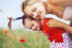 Happy Family take Fun on Flowers Meadow in Summer Royalty Free Stock Photos