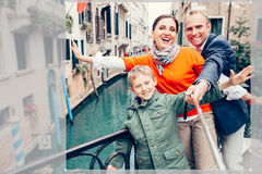 Happy family take a self photo on the one of bridges in Venice Stock Photo