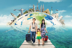 Happy family take a trip to the world monument Royalty Free Stock Image