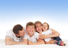 Happy family taken on a blue background Stock Photography