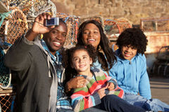 Happy family taking photo Stock Images