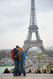 Happy family taking photo in front of Eiffel Tower Royalty Free Stock Photography