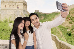 Happy family taking photo in Great Wall Stock Photography