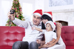 Happy family taking a photo Stock Photo
