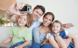 Happy family taking a photo of themselves Stock Images