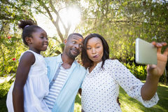 Happy family taking picture Royalty Free Stock Photos