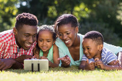 Happy family taking picture. At park Royalty Free Stock Photos