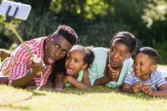 Happy family taking picture. At park Stock Images