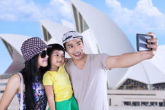 Happy family taking picture in sydney Royalty Free Stock Images