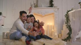 Happy family taking self portrait with smartphone during Christmas at home stock footage