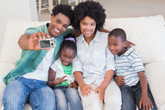 Happy family taking a selfie on the couch Royalty Free Stock Photo