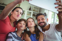 Happy family taking a selfie with digital tablet Stock Photos