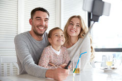 Happy family taking selfie at restaurant Royalty Free Stock Photo