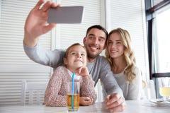 Happy family taking selfie at restaurant Royalty Free Stock Photo