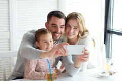 Happy family taking selfie at restaurant Royalty Free Stock Photography