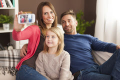 Happy family taking selfie Stock Photos