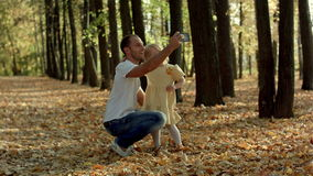 Happy family taking selfie with smartphone in stock video footage