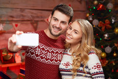 Happy family taking selfie with smartphone at home royalty free stock photos