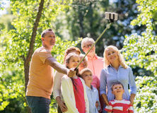 Happy family taking selfie in summer garden Royalty Free Stock Photo
