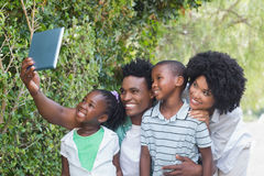 Happy family taking selfie with tablet pc Royalty Free Stock Photo