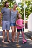 Happy family taking a walk stock photo