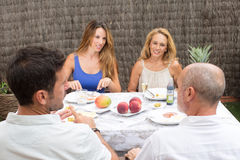 Happy family talking in garden Stock Photos