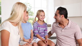 Happy family talking together Stock Photos